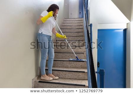 Gondnok takarítás lépcsőház fiatal női nő Stock fotó © AndreyPopov