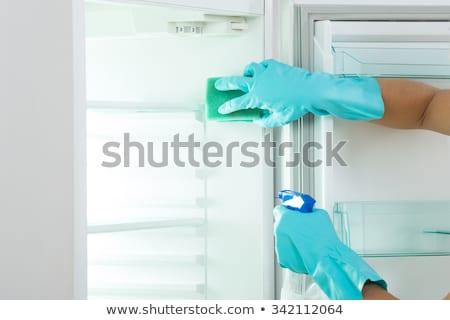 Mulher limpeza geladeira esponja feliz Foto stock © AndreyPopov