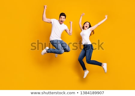 Full length of a happy couple jumping on trampoline Stock photo © galitskaya