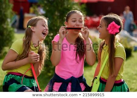 three children playing music in park stock photo © colematt