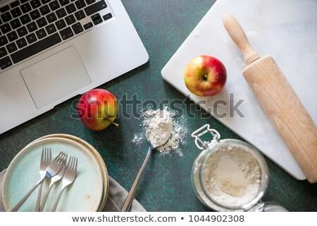 Closeup of laptop on kitchen counter  Stock photo © dashapetrenko