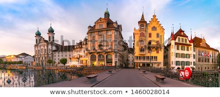 Luzern dawn view of famous landmarks and Reuss river Stock photo © xbrchx