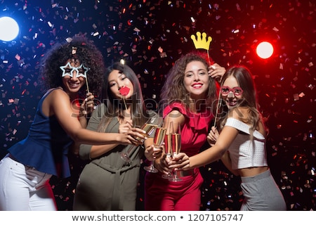 Stock photo: happy friends with party props posing