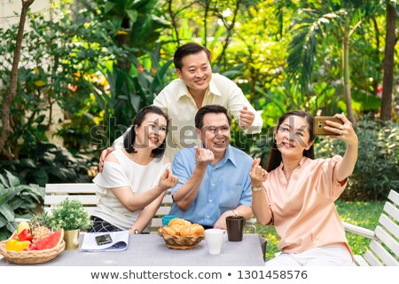senior people having fun together selfie party stock photo © robuart