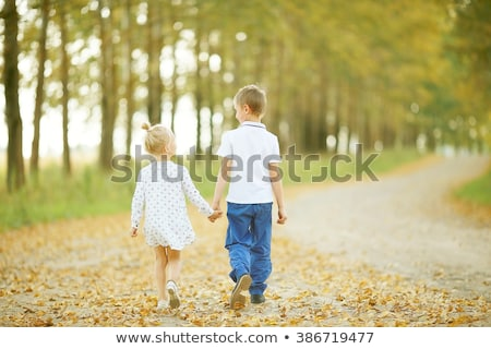 Laughing kids brother and sister playing in a forest Stock photo © ElenaBatkova
