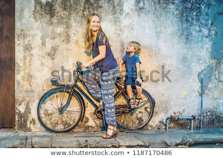 Georgetown, Penang, Malaysia - April 20, 2018: Mother and son on a bicycle. Public street art Name C Stock photo © galitskaya