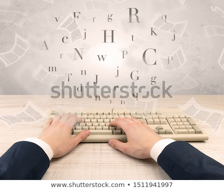 Elegant businessman hand typing with fluttering papers around Stock photo © ra2studio