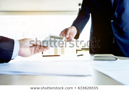 businessman send calculator to manager for estimation working, i stock photo © Freedomz