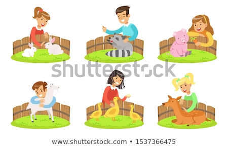 children play with the rabbits in the petting zoo Stock photo © galitskaya