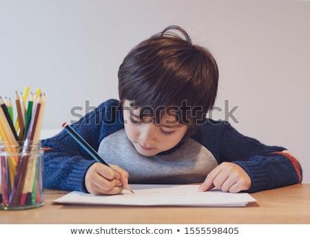 Jongen huiswerk schrijven notebook home onderwijs Stockfoto © dolgachov