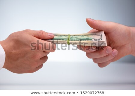 Close-up Of Two Male Hand's Holding Currency Bundle Stock photo © AndreyPopov