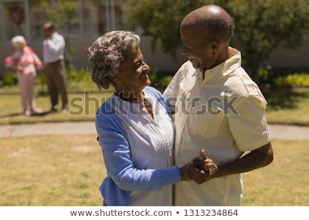 side view of senior couple dancing together in garden on as sunny day stock photo © wavebreak_media