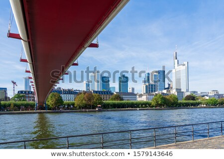 The Holbeinsteg footbridge in Frankfurt acrross Main river at ni Stock photo © manfredxy