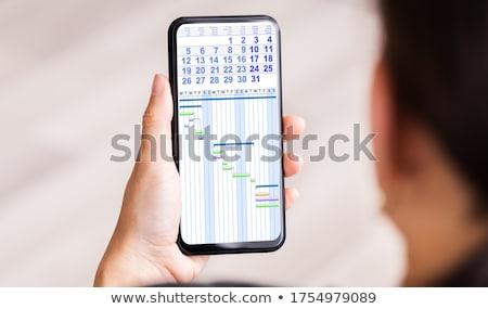Işçi gündem elektronik takvim cep telefonu el Stok fotoğraf © AndreyPopov
