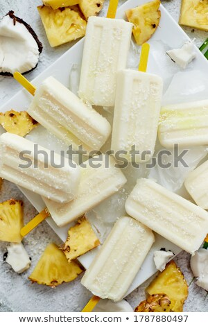 Homemade vegan popsicles made with coconut milk and pineapple. Delicious healthy summer snack Stock photo © dash