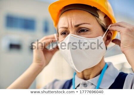 A female construction worker protecting herself. Stock photo © photography33