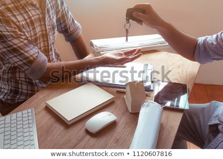 Real Estate Sign with Agent Handing Over Keys to Couple stock photo © feverpitch