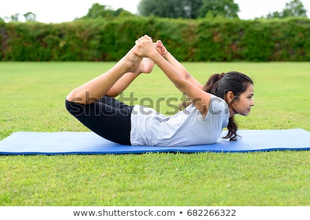 Woman practising yoga Stock photo © dash
