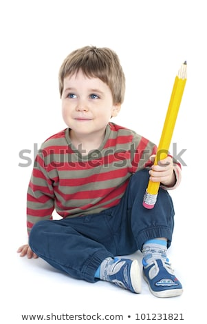 thoughtful boy holding a pencil stock photo © stockyimages