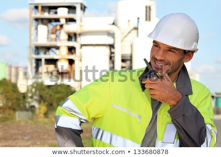 Site foreman communicating via radio receiver Stock photo © photography33