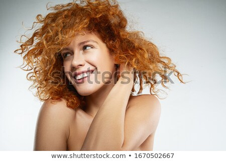 Young slim  beauty curly red hair woman posing in studio Stock photo © gromovataya