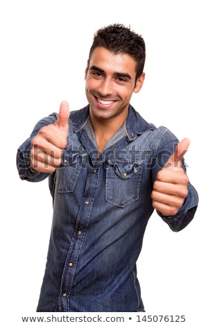 handsome young boy gesturing thumbs up sign stock photo © stockyimages