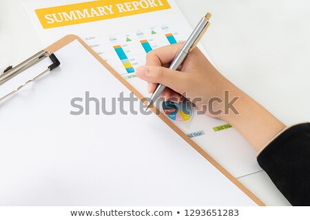 Woman reviewing notes Stock photo © photography33