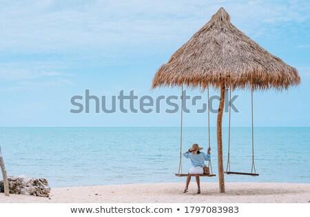 beautiful playful blonde with blue umbrella stock photo © acidgrey