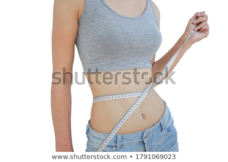 Stock fotó: Fit Young Woman Measuring Her Waistline White Background
