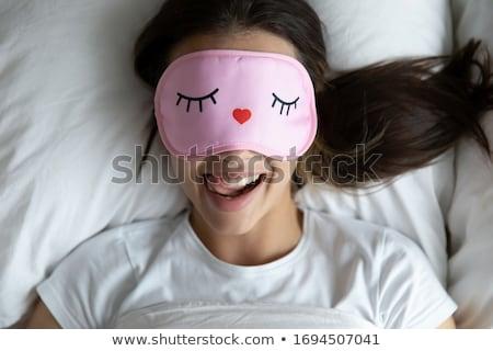 donna · occhi · open · sorridere · letto · faccia - foto d'archivio © wavebreak_media
