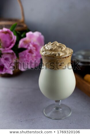 Milk cocktail and straw in goblet with chocolate Stock photo © shutswis