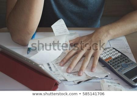 деньги женщину сидят столе кредитных карт Сток-фото © jayfish