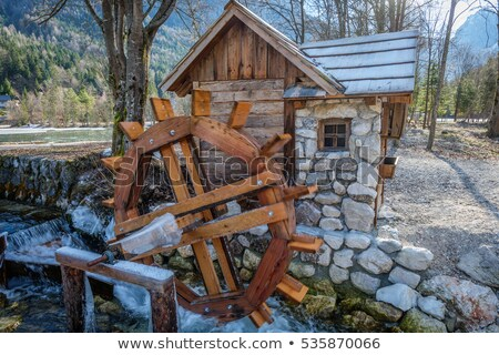 Water wheel next to a house Stock photo © kawing921