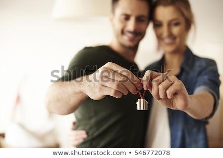 kéz · tart · öreg · kulcsok · klasszikus · fém - stock fotó © neirfy