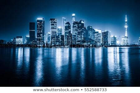 kék · tükör · üveg · homlokzat · felhőkarcoló · épületek - stock fotó © elxeneize