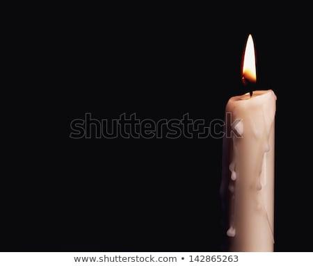 Burning candle over black. Is not isolated, just shot on black Stock photo © tolokonov