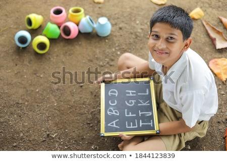 Portrait of Boy holding alphabet c Stock photo © zzve