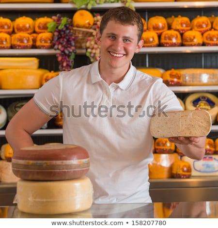 Bello maschio proprietario formaggio store piedi Foto d'archivio © HASLOO