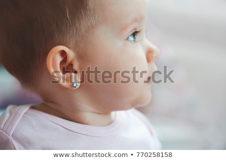 Young girl with a pierced ear Stock photo © stockyimages