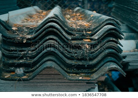 stack of unused roof tiles stock photo © smithore