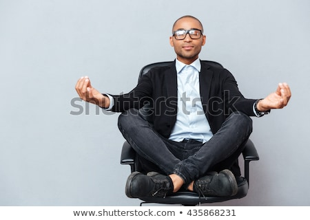 closeup businessman relaxing in lotus yoga position stock photo © w20er