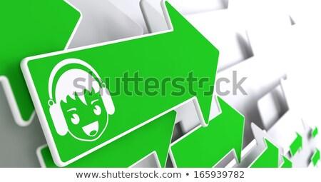 Fiú fejhallgató ikon zöld nyíl vidám fiú Stock fotó © tashatuvango