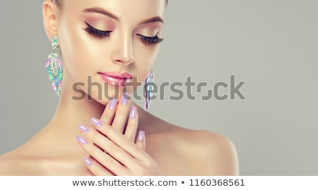 woman lips and finger with multicolored pearls stock photo © michaklootwijk
