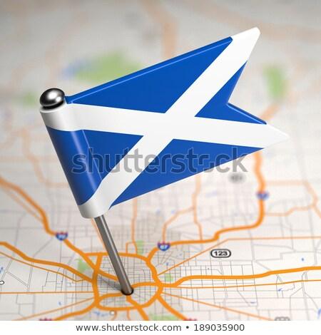 Scotland Small Flag on a Map Background. Stock photo © tashatuvango