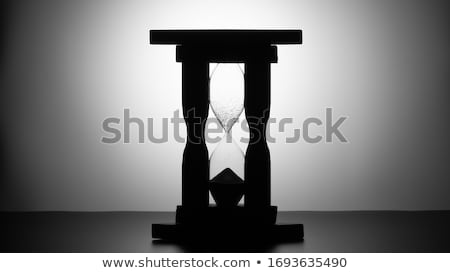ancient wooden hourglass over white Stock photo © taviphoto