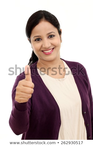 Smiling Indian young Woman showing thumb up sign isolated on white background Stock photo © bmonteny