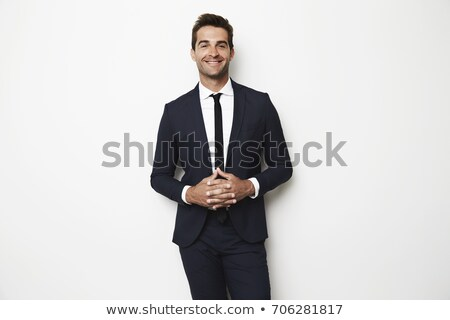Businessman in suit with hands clasped Stock photo © stockyimages