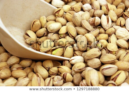 scoop of roasted and salted pistachios with focus on shelled nut Stock photo © PixelsAway