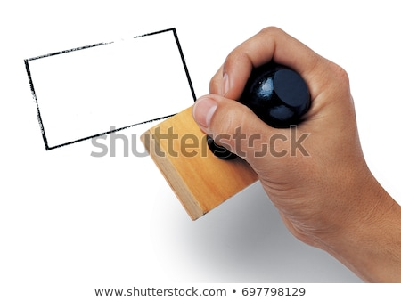 stamp in hand stock photo © fantazista