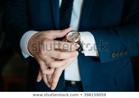 business man closing his button. Stock photo © feedough